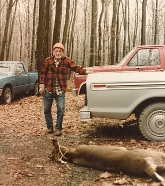 Dad with one of his many deer kills at the camp