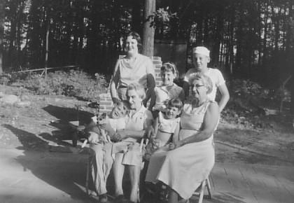Grandma Ellis holding me (front left)