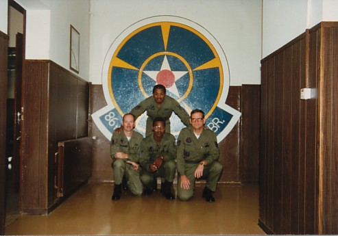 Ramstein AB, Germany.  Kneeling l to r: Phil Beckwith, Curley McQueen, Me.  Standing - John Long