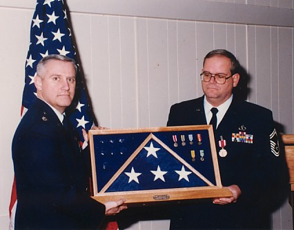 Being presented with a shadow box at retirement ceremony