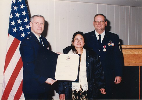 Paiboon (Jerry) receiving a Certificate of Appreciation.  She endured nearly 24 of the 26 years.