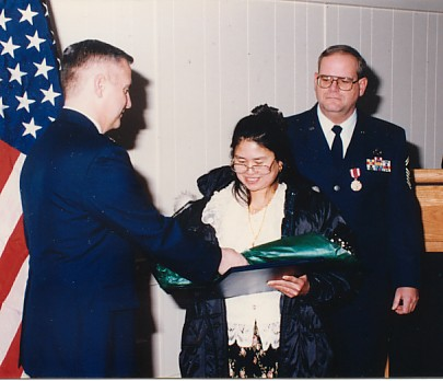 "My commander presenting my ""Real Commander"" with flowers from the Squadron"
